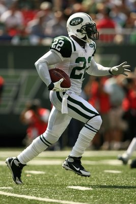 EAST RUTHERFORD, NJ - SEPTEMBER 09: Justin Miller #22 of the New York Jets carries the ball against the New England Patriots during the NFL game on September 9, 2007 at Giants Stadium in East Rutherford, New Jersey. The Patriots defeated the Jets 38-14. (