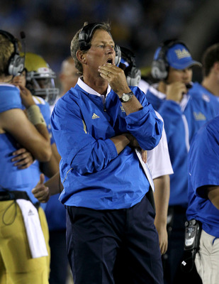 PASADENA, CA - SEPTEMBER 10: Head coach Rick Neuheisel of the UCLA Bruins looks on during the fourth quarter of the game against the San Jose State Spartans at the Rose Bowl on September 10, 2011 in Pasadena, California.  UCLA won 27-17.   (Photo by Steph