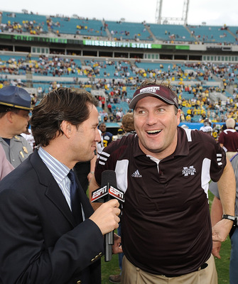 JACKSONVILLE, FL - JANUARY 01:  Mississippi State head coach Dan Mullens is interviewed by ESPN following the Bulldogs victory over the Michigan Wolverines during the Gator Bowl at EverBank Field on January 1, 2011 in Jacksonville, Florida  (Photo by Rick