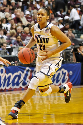 INDIANAPOLIS, IN - APRIL 3:  Maya Moore #23 of the Connecticut Huskies controls the ball against the Notre Dame Fighting Irish during the 2011 NCAA Women's Final Four at Conseco Fieldhouse on April 3, 2011 in Indianapolis, Indiana.  (Photo by Jamie Sabau/