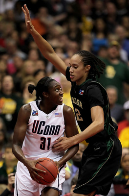 SAN ANTONIO - APRIL 04:  Tina Charles #31 of the Connecticut Huskies is defended by Brittney Griner #42 of the Baylor Bears in the first half during the Women's Final Four Semifinals at the Alamodome on April 4, 2010 in San Antonio, Texas.  (Photo by Jeff