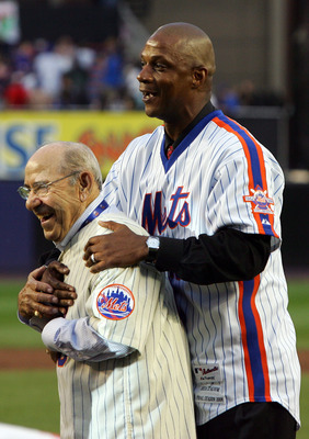 NEW YORK - SEPTEMBER 28:  Former Mets manager Yogi Berra and former Mets outfielder Daryl Strawberry hug on the field in a post game ceremony after the last regular season baseball game ever played in Shea Stadium against the Florida Marlins on September