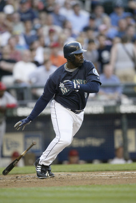 SEATTLE - JULY 3:  Designated hitter Carl Everett #8 of the Seattle Mariners swings at a Los Angeles Angels of Anaheim pitch during the game on July 3, 2006 at Safeco Field in Seattle Washington. The Angeles won 7-3.  (Photo by Otto Greule Jr/Getty Images