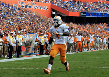 GAINESVILLE, FL - SEPTEMBER 17:  Running back Marlin Lane #4 of the Tennessee Volunteers scores a touchdown during a game against the Florida Gators at Ben Hill Griffin Stadium on September 17, 2011 in Gainesville, Florida.  (Photo by Sam Greenwood/Getty
