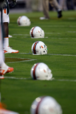 COLLEGE PARK, MD - SEPTEMBER 05:  Miami Hurricanes helmets line the field as the Hurricanes warm up before the start of thier game against the Maryland Terrapins at Byrd Stadium on September 5, 2011 in College Park, Maryland.  (Photo by Rob Carr/Getty Ima
