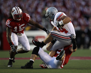 MADISON, WI - OCTOBER 16: Zach Boren #44 of the Ohio State Buckeyes is tackled by Blake Sorensen #9 and Culmer St. Jean #15 of the Wisconsin Badgers at Camp Randall Stadium on October 16, 2010 in Madison, Wisconsin. Wisconsin defeated Ohio State 31-18. (P
