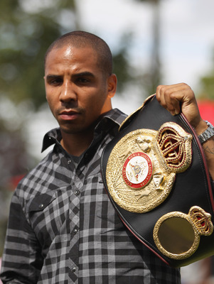 BRENTWOOD, ENGLAND - AUGUST 22:  Andre Ward of the USA poses with the WBA belt during the Carl Froch and Andre Ward Press Conference at Matchroom Sports Head Office on August 22, 2011 in Brentwood, England.  (Photo by Tom Shaw/Getty Images)