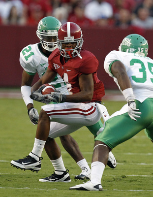TUSCALOOSA, AL - SEPTEMBER 17:  Wide receiver Marquis Maze #4 of the Alabama Crimson Tide tries to elude linebacker Zachary Orr #35 of the North Texas Mean Green and defensive back Royce Hill #21 of the North Texas Mean Green as he runs for a first down i