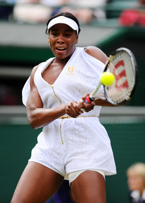 LONDON, ENGLAND - JUNE 24:  Venus Williams of the United States returns a shot during the her third round match against Maria Jose Martinez Sanchez of Spain on Day Five of the Wimbledon Lawn Tennis Championships at the All England Lawn Tennis and Croquet