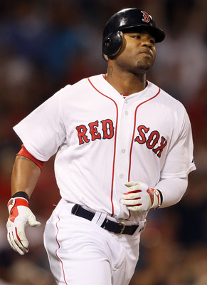 BOSTON, MA - AUGUST 30:  Carl Crawford #13 of the Boston Red Sox rounds first base after his solo home run in the fourth inning against the New York Yankees on August 30, 2011 at Fenway Park in Boston, Massachusetts.  (Photo by Elsa/Getty Images)