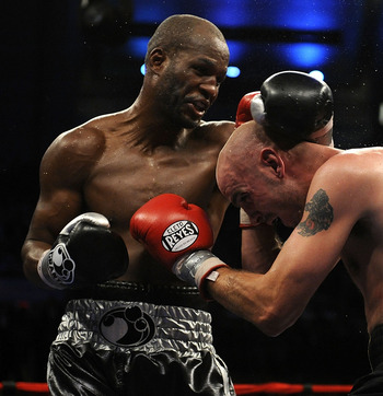 ATLANTIC CITY, NJ - OCTOBER 18:  Bernard Hopkins of Philadelphia,  Pennsylvania (L) connects to Kelly Pavlik of Youngstown, Ohio during their light heavyweight bout at Boardwalk Hall on October 18, 2008 in Atlantic City, New Jersey.  (Photo by Jeff Zeleva