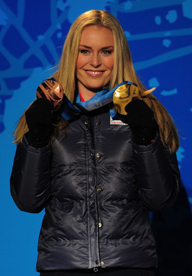 WHISTLER, BC - FEBRUARY 20:  Lindsey Vonn of the United States receives the bronze medal during the medal ceremony for the women's super-g alpine skiing held at the Whistler Medals Plaza on day 9 of the Vancouver 2010 Winter Olympics at Whistler Medals Pl