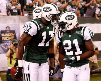 EAST RUTHERFORD, NJ - SEPTEMBER 11:  (L-R) Plaxico Burress #17 and LaDainian Tomlinson #21 of the New York Jets  celebrate after Burress scored a 26-yard touchdown reception in the fourth quarter against the Dallas Cowboys during their NFL Season Opening