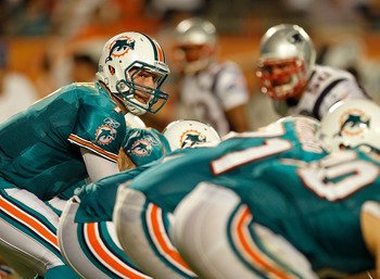 MIAMI GARDENS, FL - SEPTEMBER 12:   Chad Henne #7 of the Miami Dolphins calls a play during a game against the New England Patriots at Sun Life Stadium on September 12, 2011 in Miami Gardens, Florida.  (Photo by Mike Ehrmann/Getty Images)