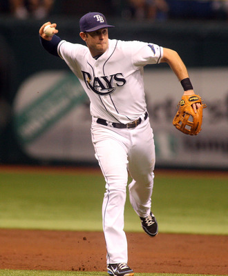 ST. PETERSBURG, FL - SEPTEMBER 3:  Evan Longoria #3 of the Tampa Bay Rays fields a ground ball and throws to first for the out against the Baltimore Orioles during the game on September 03, 2011 at Tropicana Field in St. Petersburg, Florida. The Tampa Bay