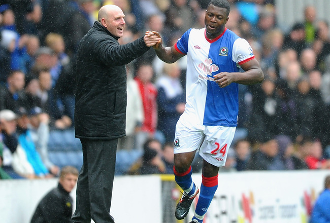 BLACKBURN, ENGLAND - SEPTEMBER 17: Steve Keane of Blackburn Rovers congratulates Yakubu on scoring the third goal during the Barclays Premier League match between Blackburn Rovers and Arsenal at Ewood Park on September 17, 2011 in Blackburn, England.  (Ph