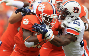 CLEMSON, SC - SEPTEMBER 17:  Andre Ellington #23 of the Clemson Tigers runs with the ball against Daren Bates #25 of the Auburn Tigers during their game at Memorial Stadium on September 17, 2011 in Clemson, South Carolina.  (Photo by Streeter Lecka/Getty