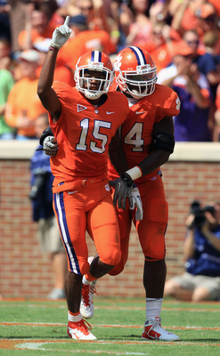 CLEMSON, SC - SEPTEMBER 17:  Teammates Coty Sensabaugh #15 of the Clemson Tigers and Martin Jenkins #14 celebrate after Sensabaugh intercepted a pass during their game at Memorial Stadium on September 17, 2011 in Clemson, South Carolina.  (Photo by Street