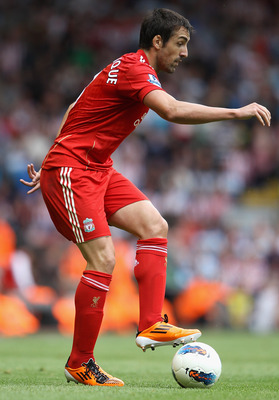LIVERPOOL, ENGLAND - AUGUST 13:  Jose Enrique of Liverpool in action during the Barclays Premier League match between Liverpool and Sunderland at Anfield on August 13, 2011 in Liverpool, England.  (Photo by Clive Brunskill/Getty Images)