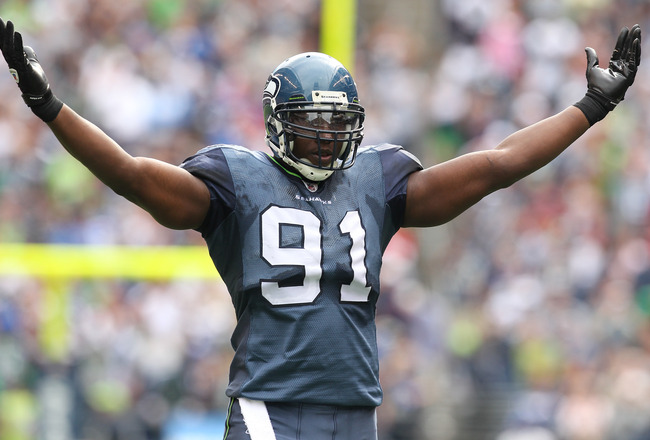 SEATTLE - SEPTEMBER 12:  Defensive end Chris Clemons #91 of the Seattle Seahawks encourages the cheering crowd during the NFL season opener against the San Francisco 49ers at Qwest Field on September 12, 2010 in Seattle, Washington. (Photo by Otto Greule