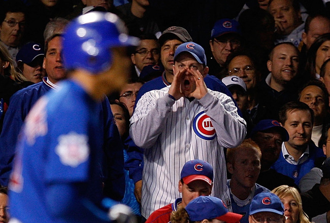 CHICAGO - OCTOBER 02:  A fan of the Chicago Cubs boos Kosuke Fukudome #1 of the Cubs after he struck out looking in the bottom of the fifth inning against the Los Angeles Dodgers in Game Two of the NLDS during the 2008 MLB Playoffs at Wrigley Field on Oct