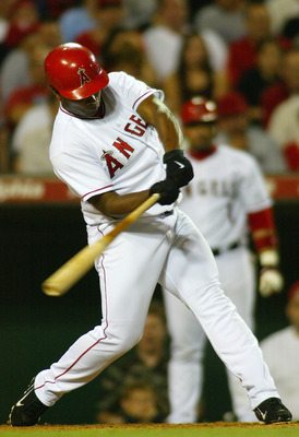 ANAHEIM, CA - MAY 4:  Jose Guillen #6 of the Anaheim Angels hits a home run in the fifth inninng against the Detroit Tigers on May 4, 2004 at Angel Stadium in Anaheim, California.  (Photo by Lisa Blumenfeld/Getty Images)