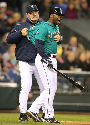 SEATTLE - MAY 06:  Milton Bradley #15 of the Seattle Mariners is restrained by manager Eric Wedge #22 after being ejected from the game against the Chicago White Sox at Safeco Field on May 6, 2011 in Seattle, Washington. The Mariners won 3-2. (Photo by Ot