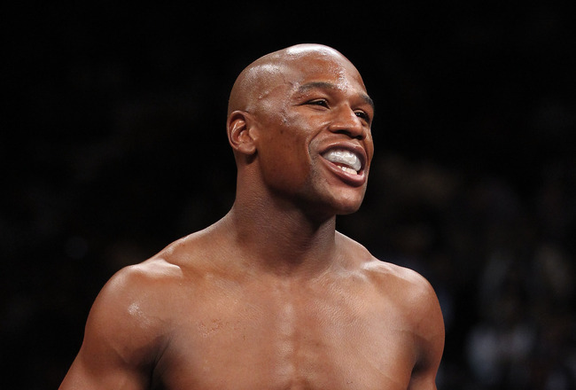 LAS VEGAS, NV - SEPTEMBER 17:  Floyd Mayweather Jr. smiles in the ring as he takes on Victor Ortiz during their WBC welterweight title fight at the MGM Grand Garden Arena on September 17, 2011 in Las Vegas, Nevada.  (Photo by Al Bello/Getty Images)