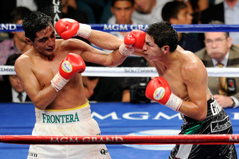 LAS VEGAS, NV - SEPTEMBER 17:  (L-R) Erik Morales of Mexico  and Pablo Cesar Cano of Mexico exchange blows during their WBC super lightweight title fight at the MGM Grand Garden Arena on September 17, 2011 in Las Vegas, Nevada.  (Photo by Ethan Miller/Get