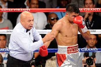LAS VEGAS, NV - SEPTEMBER 17:  Referee Joe Cortez calls a minus point to Victor Ortiz for a head-butt in the fourth round against Floyd Mayweather Jr. during their WBC welterweight title fight at the MGM Grand Garden Arena on September 17, 2011 in Las Veg
