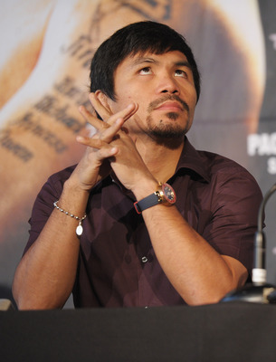 NEW YORK, NY - SEPTEMBER 06:  Professional Boxer Manny Pacquiao (pictured) attends the press conference for his World Welterweight Championship Fight with Juan Manuel Marquez at The Lighthouse at Chelsea Piers on September 6, 2011 in New York City.  (Phot