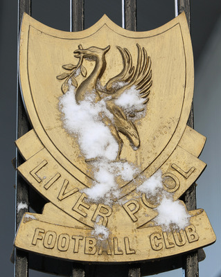LIVERPOOL, UNITED KINGDOM - JANUARY 09:  A Liverpool FC crest is seen splattered with snow outside Anfield the home ground of Liverpool FC as hazardous conditions has led to their Barclays Premier League match against Tottenham Hotspur tomorrow to be post