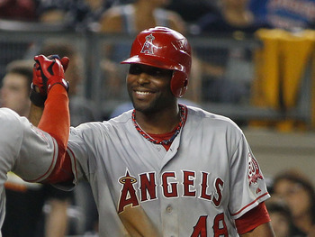 NEW YORK, NY - AUGUST 09:  Bobby Abreu #53 of the Los Angeles Angels of Anaheim is greeted by teammate Torii Hunter #48 after hitting a two run homerun in the top of the ninth inning against the New York Yankees on August 09, 2011 at Yankee Stadium in the