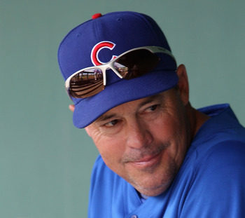 SCOTTSDALE, AZ - MARCH 01:  Greg Maddux of the Chicago Cubs sits in the dugout before the spring training game against the San Francisco Giants at Scottsdale Stadium on March 1, 2011 in Scottsdale, Arizona.  (Photo by Christian Petersen/Getty Images)