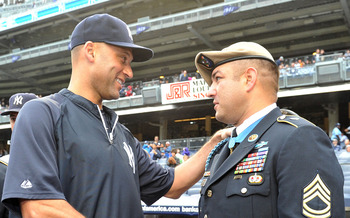 NEW YORK, NY - SEPTEMBER 07: Derek Jeter #2 of the New York Yankees (L) shakes hands with Metal of Honor recipient Leroy Petry during a pregame ceremony commemorating the Tenth Anniversary of the September 11th attacks on September 7, 2011 at Yankee Stadi