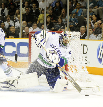 SAN JOSE, CA - SEPTEMBER 29: Goalie Eddie Lack #76 of the Vancouver Canucks pushes the puck away from the net during their preseason game against the San Jose Sharks at the HP Pavilion on September 29, 2010 in San Jose, California. (Photo by Thearon W. He