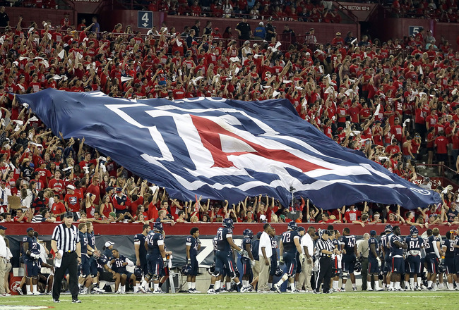 TUCSON, AZ - SEPTEMBER 17:  Fans of the Arizona Wildcats hold up a school flag during the college football game against the Stanford Cardinal at Arizona Stadium on September 17, 2011 in Tucson, Arizona. The Cardinal defeated the Wildcats 37-10. (Photo by