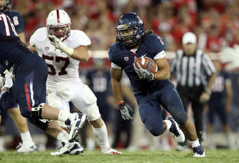 TUCSON, AZ - SEPTEMBER 17:  Runningback Keola Antolin #2 of the Arizona Wildcats rushes the football against the Stanford Cardinal during the college football game at Arizona Stadium on September 17, 2011 in Tucson, Arizona. The Cardinal defeated the Wild