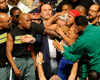 Mayweather and Ortiz at the weigh-in.
