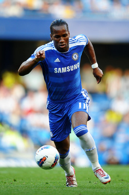 LONDON, ENGLAND - AUGUST 20:  Didier Drogba of Chelsea runs with the ball during the Barclays Premier League match between Chelsea and West Bromwich Albion at Stamford Bridge on August 20, 2011 in London, England.  (Photo by Laurence Griffiths/Getty Image