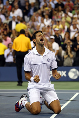 NEW YORK, NY - SEPTEMBER 12:  Novak Djokovic of Serbia reacts after he won match point against Rafael Nadal of Spain during the Men's Final on Day Fifteen of the 2011 US Open at the USTA Billie Jean King National Tennis Center on September 12, 2011 in the