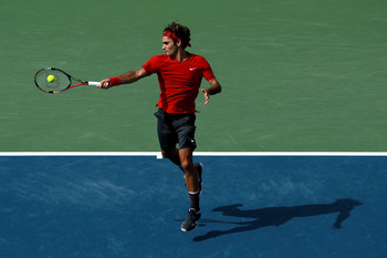 NEW YORK, NY - SEPTEMBER 10:  Roger Federer of Switzerland hits a forehand return against Novak Djokovic of Serbia during Day Thirteen of the 2011 US Open at the USTA Billie Jean King National Tennis Center on September 10, 2011 in the Flushing neighborho