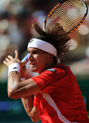CORDOBA, SPAIN - SEPTEMBER 16:  David Ferrer of Spain in action in his match against Gilles Simon of France during day one of the semi final Davis Cup match between Spain and France at the Plaza de Toros de los Califas on September 16, 2011 in Cordoba, Sp