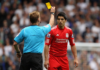 Mike Jones Makes a Performance of Giving Luis Suarez a Yellow Card
