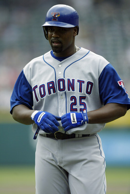ARLINGTON, TX - MAY 8:  Carlos Delgado #25 of the Toronto Blue Jays stands on the field during the game against the Texas Rangers at the Ballpark in Arlington on May 8, 2003 in Arlington, Texas.  The Blue Jays defeated the Rangers 8-6.  (Photo by Ronald M