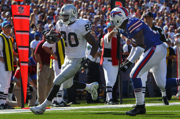 ORCHARD PARK, NY - SEPTEMBER 18: Darren McFadden #20 of the Oakland Raiders rushes for a touchdown during an NFL game against the Buffalo Bills at Ralph Wilson Stadium on September 18, 2011 in Orchard Park, New York. (Photo by Tom Szczerbowski/Getty Image
