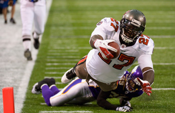 MINNEAPOLIS, MN - SEPTEMBER 18: LeGarrette Blount #27 of the Tampa Bay Buccaneers scores a touchdown against the Minnesota Vikings in the third quarter on September 18, 2011 at Hubert H. Humphrey Metrodome in Minneapolis, Minnesota. (Photo by Hannah Fosli