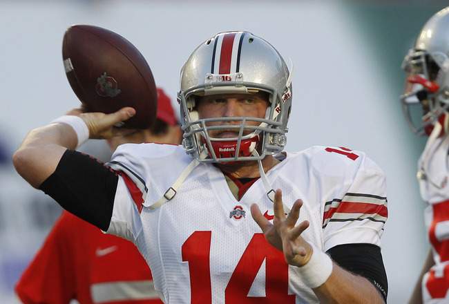 MIAMI, FL - SEPTEMBER 17: Joe Bauserman #14 of the Ohio State Buckeyes throws the ball prior to the game against the Miami Hurricanes on September 17, 2011 at Sun Life Stadium in Miami, Florida. (Photo by Joel Auerbach/Getty Images)