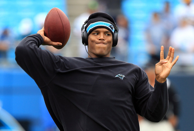 CHARLOTTE, NC - SEPTEMBER 18:  Cam Newton #1 of the Carolina Panthers warms up before the game against the Green Bay Packers during their game at Bank of America Stadium on September 18, 2011 in Charlotte, North Carolina.  (Photo by Streeter Lecka/Getty I