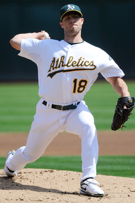 OAKLAND, CA - SEPTEMBER 14: Rich Harden #18 of the Oakland Athletics pitches against the Los Angeles Angels of Anaheim during an MLB baseball game at O.co Coliseum on September 14, 2011 in Oakland, California.  (Photo by Thearon W. Henderson/Getty Images)